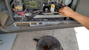 Draining engine oil